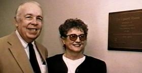 Stan Evans and Norma Lipsett stand before the Commemorative Plaque outside the Lipsett Room